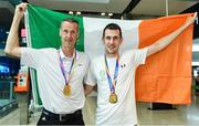 24 July 2017; Micheal McKillop of Team Ireland, right, who won gold in both the T38 800m and T37 1500m, pictured with his father Paddy McKillop during the Homecoming of the Irish Team from the World Para Athletics Championships in London at Dublin Airport. Photo by Sam Barnes/Sportsfile