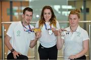 24 July 2017; Team Ireland athletes, from left, Micheal McKillop, who won gold in both the T38 800m and T37 1500m, Niamh McCarthy, who won silver in the F41 Discus and Noelle Lenihan, who won silver in the F38 Discus, picture during the Homecoming of the Irish Team from the World Para Athletics Championships in London at Dublin Airport. Photo by Sam Barnes/Sportsfile