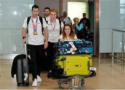 24 July 2017; Team Ireland athletes, from left, Micheal McKillop, who won gold in both the T38 800m and T37 1500m, Noelle Lenihan, who won silver in the F38 Discus and Niamh McCarthy, who won silver in the F41 Discus, pictured during the Homecoming of the Irish Team from the World Para Athletics Championships in London at Dublin Airport. Photo by Sam Barnes/Sportsfile