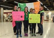 24 July 2017; Michaela Walsh, who won bronze in the Hammer, pictured with her cousins Mikey Gallagher, right, age 13, and Dylan Gallagher, age 10, and other family members at the homecoming of the Irish Team from the European Athletics Under-20 Championships in Italy at Dublin Airport. Photo by Sam Barnes/Sportsfile