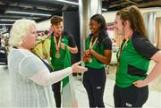 24 July 2017; Team Ireland Athletes, from left,  John Fitzsimons, who won bronze in the men's 800m, Gina Apke-Moses, who won gold in the 100m, and Michaela Walsh, who won bronze in the Hammer, are presented with flowers by Athletics Ireland President Georgina Drumm at the homecoming of the Irish Team from the European Athletics Under-20 Championships in Italy at Dublin Airport.  Photo by Sam Barnes/Sportsfile
