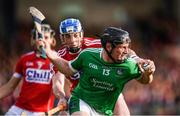 26 July 2017; Peter Casey of Limerick in action against Sean O'Donoghue of Cork during the Bord Gáis Energy Munster GAA Hurling Under 21 Championship Final match between Limerick and Cork at the Gaelic Grounds in Limerick. Photo by Stephen McCarthy/Sportsfile