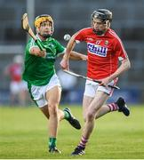 26 July 2017; Jack O'Connor of Cork in action against Thomas Grimes of Limerick during the Bord Gáis Energy Munster GAA Hurling Under 21 Championship Final match between Limerick and Cork at the Gaelic Grounds in Limerick. Photo by Stephen McCarthy/Sportsfile