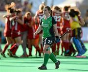 25 March 2012; Elizabeth Colvin, Ireland, leaves the pitch following her side's defeat as Belgium celebrate their qualification for the London 2012 Olympic Games. Women's 2012 Olympic Qualifying Tournament Final, FIH Road to London, Belgium v Ireland, Beerschot T.H.C., Kontich, Antwerp, Belgium. Picture credit: Stephen McCarthy / SPORTSFILE