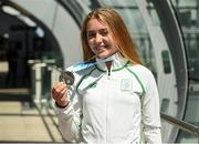 30 July 2017; Team Ireland arrive at Dublin Airport with 6 medals following competition at the 2017 European Youth Olympic Festival, EYOF, in Gyor, Hungary. The multi-sport event saw 40 Irish athletes, aged 14-16, compete against the best youth athletes in Europe. The six sports represented by Ireland were Athletics, Cycling, Swimming, Judo, Tennis and Gymnastics. Pictured is Team Ireland's Lara Gillespie, from Enniskerry, Co. Wicklow, with her silver medal for second place in the women's cycling time trial, at Dublin Airport, Dublin. Photo by Seb Daly/Sportsfile