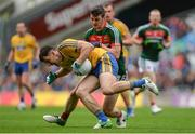 30 July 2017; Diarmuid Murtagh of Roscommon in action against Brendan Harrison of Mayo during the GAA Football All-Ireland Senior Championship Quarter-Final match between Mayo and Roscommon at Croke Park in Dublin. Photo by Piaras Ó Mídheach/Sportsfile