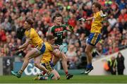 30 July 2017; Cillian O'Connor of Mayo looks on after kicking a wide under pressure from Roscommon's, from left, Fintan Cregg, Niall McInerney and Ronan Stack during the GAA Football All-Ireland Senior Championship Quarter-Final match between Mayo and Roscommon at Croke Park in Dublin. Photo by Piaras Ó Mídheach/Sportsfile