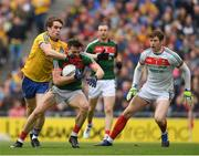 30 July 2017; Jason Doherty of Mayo supported by goalkeeper David Clarke prepares to clear under pressure from David Murray of Roscommon during the GAA Football All-Ireland Senior Championship Quarter-Final match between Mayo and Roscommon at Croke Park in Dublin. Photo by Ray McManus/Sportsfile