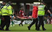 31 July 2017; Warren O'Hora of Bohemians is stretchered off by medical staff during the SSE Airtricity League Premier Division match between Cork City and Bohemians at Turners Cross, in Cork. Photo by David Maher/Sportsfile