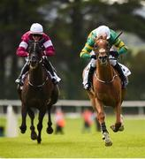 1 August 2017; Housesofparliament, right, with Barry Geraghty up, race ahead of Morgan, with Keith Donoghue up, who finished second, on their way to winning the Colm Quinn BMW Novice Hurdle during the Galway Races Summer Festival 2017 at Ballybrit, in Galway. Photo by Cody Glenn/Sportsfile
