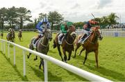 1 August 2017; Eventual winner Shekiba, right, with Gary Carroll up, race ahead of Raynama, with Pat Smullen up, who finished fourth, and Moghamarah, with Chris Hayes up, who finished second, on their way to winning the Colm Quinn BMW Irish EBF  Fillies Maiden during the Galway Races Summer Festival 2017 at Ballybrit, in Galway. Photo by Cody Glenn/Sportsfile