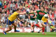 30 July 2017; Andy Moran of Mayo is tackled by Enda Smith of Roscommon during the GAA Football All-Ireland Senior Championship Quarter-Final match between Mayo and Roscommon at Croke Park in Dublin. Photo by Ramsey Cardy/Sportsfile