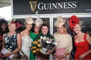 3 August 2017; Jockey Barry Geraghty celebrates with the trophy and friends including Geraghty's wife Paula Geraghty, fourth from left, and Noreen McManus, second from right, wife of owner JP McManus, after winning the Guinness Galway Hurdle Handicap on Tigris River during the Galway Races Summer Festival 2017 at Ballybrit, in Galway. Photo by Cody Glenn/Sportsfile