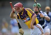 15 April 2012; Paul Morris, Wexford, in action against Cahir Healy, Laois. Allianz Hurling League Division 1B Relegtion Play-off, Wexford v Laois, Nowlan Park, Kilkenny. Picture credit: Brian Lawless / SPORTSFILE