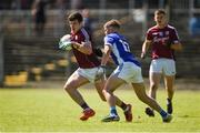 5 August 2017; Evan Murphy of Galway in action against Ryan Coyle of Cavan during the Electric Ireland All-Ireland GAA Football Minor Championship Quarter-Final match between Cavan and Galway at Páirc Seán Mac Diarmada in Carrick-on-Shannon, Leitrim. Photo by Barry Cregg/Sportsfile