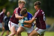 5 August 2017; Oisin Pierson of Cavan in action against Conor Campbell, left, and Sean Fitzgerald of Galway during the Electric Ireland All-Ireland GAA Football Minor Championship Quarter-Final match between Cavan and Galway at Páirc Seán Mac Diarmada in Carrick-on-Shannon, Leitrim. Photo by Barry Cregg/Sportsfile