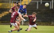 5 August 2017; Philip Rogers of Cavan in action against, from left, Eoin McFadden, Brian Harlowe and Jack Glynn of Galway during the Electric Ireland All-Ireland GAA Football Minor Championship Quarter-Final match between Cavan and Galway at Páirc Seán Mac Diarmada in Carrick-on-Shannon, Leitrim. Photo by Barry Cregg/Sportsfile