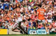 5 August 2017; Declan McClure of Tyrone is tackled by Jamie Clarke of Armagh during the GAA Football All-Ireland Senior Championship Quarter-Final match between Tyrone and Armagh at Croke Park in Dublin. Photo by Ramsey Cardy/Sportsfile