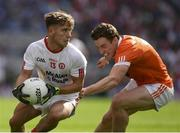 5 August 2017; Mark Bradley of Tyrone in action against Charlie Vernon of Armagh during the GAA Football All-Ireland Senior Championship Quarter-Final match between Tyrone and Armagh at Croke Park in Dublin. Photo by Ray McManus/Sportsfile