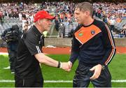 5 August 2017; Tyrone manager Mickey Harte shakes hands with Armagh manager Kieran McGeeney following the GAA Football All-Ireland Senior Championship Quarter-Final match between Tyrone and Armagh at Croke Park in Dublin. Photo by Ramsey Cardy/Sportsfile