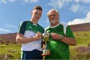5 August 2017; Cathal Kiely of Offaly after winning the U16 Hurling event with Poc Fada sponsor Martin Donnelly of MD Sport after the 2017 M Donnelly GAA All-Ireland Poc Fada Finals in the Annaverna Mountain, Ravensdale, Co Louth. Photo by Piaras Ó Mídheach/Sportsfile