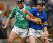 8 August 2002; Mark Keane, Limerick, in action against Tipperary's Dermot Gleeson. Tipperary v Limerick, Munster U-21 Hurling Final, Semple Stadium, Thurles, Co. Tipperary. Picture credit; Damien Eagers / SPORTSFILE *EDI*