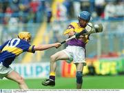 11 August 2002; Tipperary's Pat Shortt in action against Joe Codd, Wexford. Tipperary v Wexford, All Ireland Minor Hurling Semi - Final, Croke Park, Dublin. Picture credit; Damien Eagers / SPORTSFILE