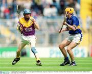 11 August 2002; Joe Codd, Wexford, in action against David Kennedy, Tipperary. Tipperary v Wexford, All Ireland Minor Hurling Semi - Final, Croke Park, Dublin. Picture credit; Aoife Rice / SPORTSFILE