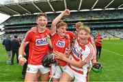 6 July 2017; Cork's Colin O'Brien, left, Daire Connery, centre, and Luke Donovan celebrate following the All Ireland U17 Hurling Championship Final match between Dublin and Cork at Croke Park in Dublin. Photo by Ramsey Cardy/Sportsfile