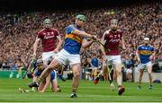 6 August 2017; John O'Dwyer of Tipperary shoots as Galway's Cathal Mannion, left, and Padraig Mannion look on during the GAA Hurling All-Ireland Senior Championship Semi-Final match between Galway and Tipperary at Croke Park in Dublin. Photo by Piaras Ó Mídheach/Sportsfile