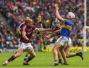 6 August 2017; Ronan Maher of Tipperary hand passes under pressure from Galway players Conor Whelan, left, and Gearoid McInerney during the GAA Hurling All-Ireland Senior Championship Semi-Final match between Galway and Tipperary at Croke Park in Dublin. Photo by Ray McManus/Sportsfile