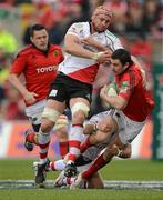 8 April 2012; Felix Jones, Munster, is tackled by Dan Tuohy, left, and Paddy Wallace, Ulster. Heineken Cup Quarter-Final, Munster v Ulster, Thomond Park, Limerick. Picture credit: Stephen McCarthy / SPORTSFILE