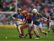 6 August 2017; Aoife Ní Drisceoil of Scoil Lorcáin, Baile na Manach, Co Dublin, representing Galway, in action against Caoimhe Sheehan of Scoil Mhuire, Milford, Charleville, Co Cork, representing Tipperary, and Sarah Lambe of Lurgybrack NS, Letterkenny, Co Donegal, representing Tipperary, during INTO Cumann na mBunscol GAA Respect Exhibition Go Games at Galway v Tipperary - GAA Hurling All-Ireland Senior Championship Semi-Final at Croke Park in Dublin Photo by Ray McManus/Sportsfile