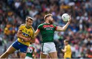 7 August 2017; Aidan O'Shea of Mayo in action against Enda Smith of Roscommon during the GAA Football All-Ireland Senior Championship Quarter-Final Replay match between Mayo v Roscommon at Croke Park, in Dublin. Photo by Ray McManus/Sportsfile