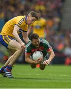 7 August 2017; Chris Barrett of Mayo in action against Cathal Compton of Roscommon during the GAA Football All-Ireland Senior Championship Quarter-Final Replay match between Mayo v Roscommon at Croke Park, in Dublin. Photo by Daire Brennan/Sportsfile