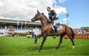9 August 2017; Greg Patrick Broderick celebrates with a lap of honour on Zuidam, after winning The Speed Stakes, the first international competition of the show, during the Dublin Horse Show at the RDS in Ballsbridge, Dublin. Photo by Cody Glenn/Sportsfile
