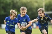 9 August 2017; Joshua Glynne in action against Cillian Roe, left, and Luke McKenna during the Bank of Ireland Leinster Rugby Summer Camp at De La Salle RFC in Glenamuck North, Dublin. Photo by Matt Browne/Sportsfile