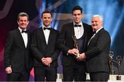 3 November 2017; Galway hurler Gearóid McInerney is presented with his PwC All Star award from Uachtarán Chumann Lúthchleas Gael Aogán Ó Fearghail, in the company of Feargal O'Rourke, left, Managing Partner, PwC, and David Collins, GPA President during the PwC All Stars 2017 at the Convention Centre in Dublin. Photo by Brendan Moran/Sportsfile