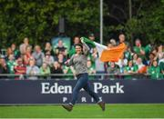 9 August 2017; An Irish supporter runs across the pitch during the 2017 Women's Rugby World Cup Pool C match between Ireland and Australia at the UCD Bowl in Belfield, Dublin. Photo by Eóin Noonan/Sportsfile