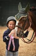 10 August 2017; Aisling Grant, age 7, from Donabate, Co Dublin, pats goodbye to her pony after her pony ride at the Dublin Horse Show at the RDS in Ballsbridge, Dublin. Photo by Cody Glenn/Sportsfile