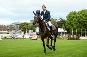 10 August 2017; Bertram Allen of Ireland celebrates with a lap of honour on Izzy By Picobello after winning the Anglesea Serpentine Stakes at Dublin Horse Show at the RDS in Ballsbridge, Dublin. Photo by Cody Glenn/Sportsfile