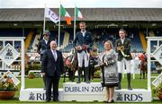 10 August 2017; Bertram Allen of Ireland, centre, who finished first on Izzy By Picobello, alongside Karen Polle of Japan, left, who finished second on With Wings, and Greg Broderick of Ireland, right, who finished third on Chinook II, are presented with their ribbons by Michael Ring TD Minister for Community and Rural Affairs and President of RDS Bernie Brennan after the Anglesea Serpentine Stakes at Dublin Horse Show at the RDS in Ballsbridge, Dublin. Photo by Cody Glenn/Sportsfile