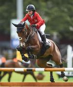 10 August 2017; Laura Kraut of USA competing on Curious George during the Anglesea Serpentine Stakes at Dublin Horse Show at the RDS in Ballsbridge, Dublin. Photo by Cody Glenn/Sportsfile