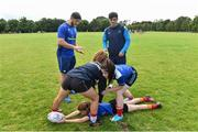 9 August 2017; Leinster academy players Vakh Abdaladze and Jimmy O'Brien coaching players during the Bank of Ireland Leinster Rugby School of Excellence event at Kings Hospital in Palmerstown, Dublin. Photo by Matt Browne/Sportsfile