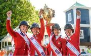 11 August 2017; Members of the winning USA team, from left, Lillie Keenan, Lauren Hough, Laura Kraut and Elizabeth Madden lift the Aga Khan following the FEI Nations Cup during the Dublin International Horse Show at RDS, Ballsbridge in Dublin. Photo by Cody Glenn/Sportsfile