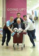 2 May 2012; Drogheda United manager Mick Cooke with players Derek Prendergast, left, Gabriel Sava, and Gavin Brennan, right, at the announcement of Scotch Hall Shopping Centre, Drogheda, as Drogheda United's main jersey sponsor. Scotch Hall Shopping Centre, Drogheda, Co. Louth. Picture credit: Paul Mohan / SPORTSFILE