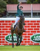 12 August 2017; Co-winner Daniel Coyle of Ireland celebrates clearing Land Rover Puisance on Cavalier Rusticana during the Dublin International Horse Show at RDS, Ballsbridge in Dublin. Photo by Cody Glenn/Sportsfile