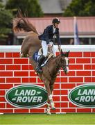 12 August 2017; Eventual co-winner Christopher Megahey of Ireland clears the Land Rover Puisance on Seapatrick Cruise Cavalier during the Dublin International Horse Show at RDS, Ballsbridge in Dublin. Photo by Cody Glenn/Sportsfile