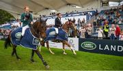 12 August 2017; Co-winners Daniel Coyle of Ireland, left, on Cavalier Rusticana and Christopher Megahey of Ireland on Seapatrick Cruise Cavalier celebrate with a lap of honour after winning the Land Rover Puissance during the Dublin International Horse Show at RDS, Ballsbridge in Dublin. Photo by Cody Glenn/Sportsfile