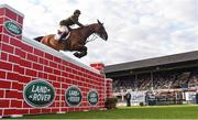 12 August 2017; Eventual second place-finisher Capt. Geoff Curran of Ireland clearing the obstacle on Dollanstown in the Land Rover Puissance during the Dublin International Horse Show at RDS, Ballsbridge in Dublin. Photo by Cody Glenn/Sportsfile